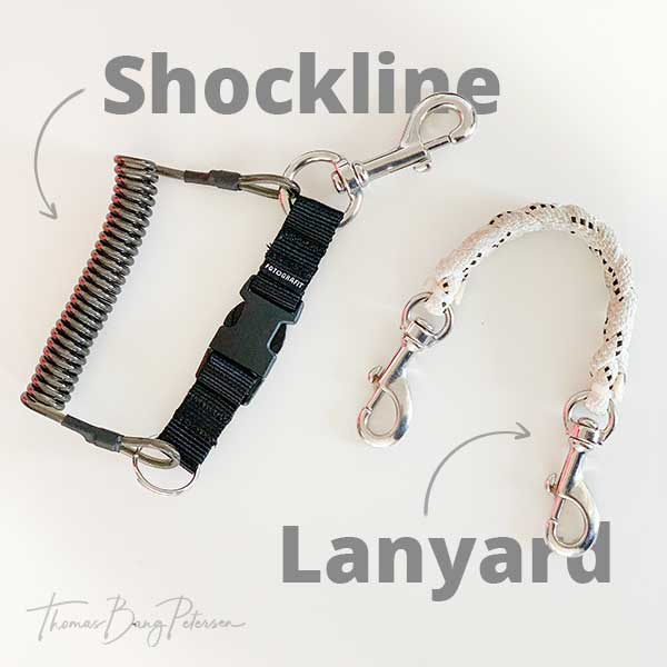 Shockline and lanyard for underwater housing